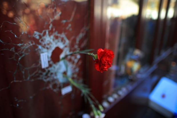 2015 pictures of the year Paris attacks rose in bullet hole Nov 15