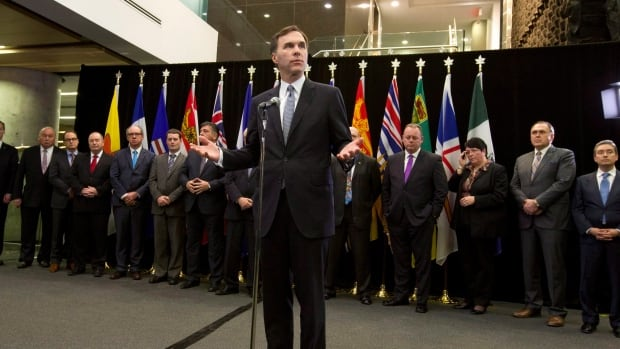 Federal Finance Minister Bill Morneau holds a news conference with his provincial and territorial counterparts after concluding a meeting in Ottawa, Monday, December 21, 2015.