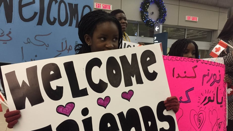 Regina residents welcome the first group of government-sponsored Syrian refugees in the city, in December, 2015.