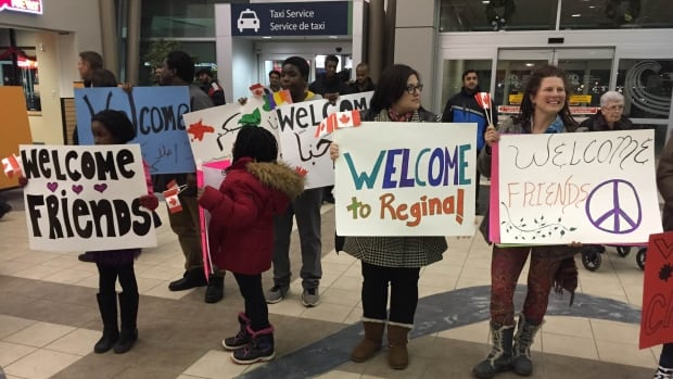 A group of Regina residents gathered at the airport on Dec. 21 to welcome Syrian refugees to the city.