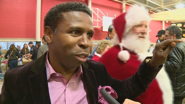 """Michael 'Pinball' Clemons said events like Project Engagement's 11th annual food drive are reminders """"that in community, our responsibility is to share."""""""