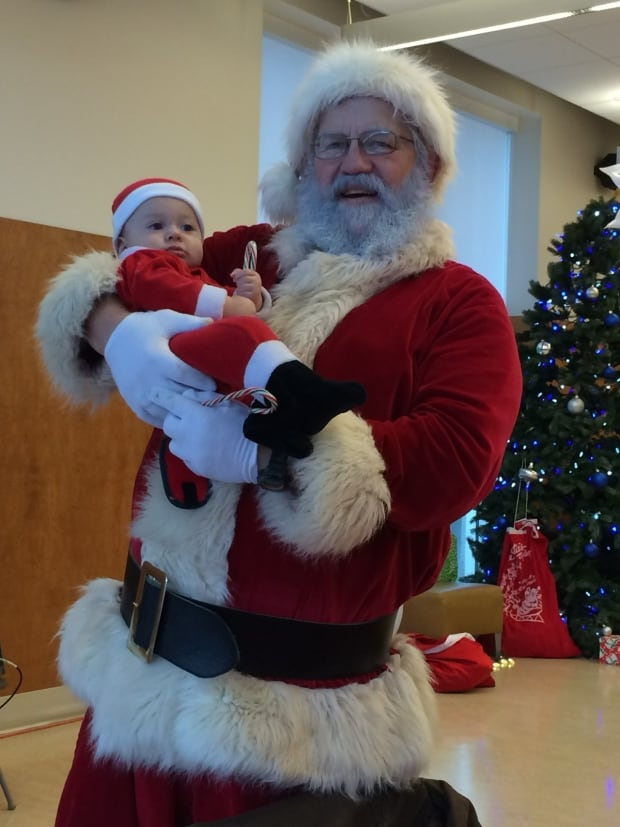 Dick Woldring, aka Santa and mini Santa and candy canes