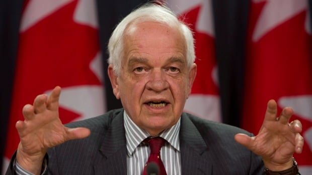 Immigration Minister John McCallum told reporters Wednesday more than 10,000 Syrian refugees will have been confirmed as permanent residents before year's end - but said he could not guarantee their arrival in Canada in that time.