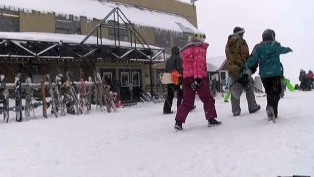 Snowboarders walk at Vancouver Island's Mount Washington Alpine Resort.