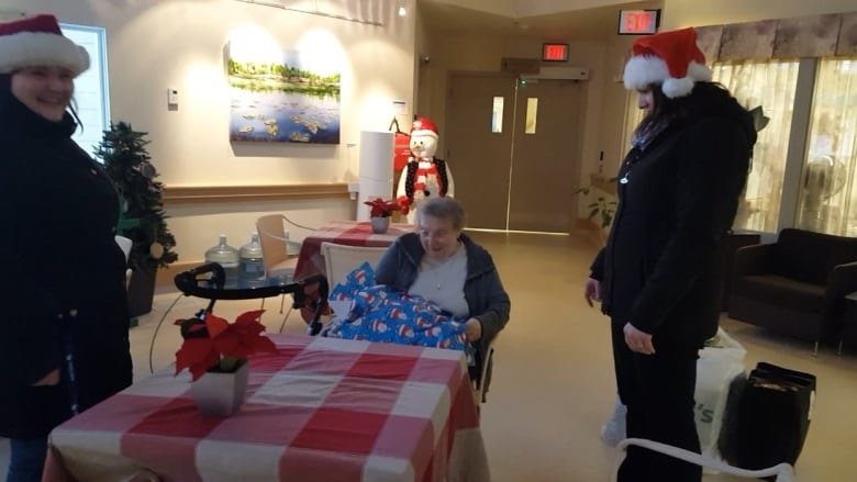 ab4d86ccc3bf Jennifer Pagonis (left) and Diane Pagonis present a Christmas gift of  pajamas to Avens resident Annette LeMay. The Pagonis sisters gave nearly  100 sets of ...