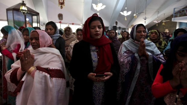 People attend a mass on Christmas day at Fatima Church in Islamabad, Pakistan, December 25, 2015. The earthquake was felt in the capital, where some people remained outside of their homes in fear of aftershocks.