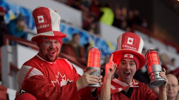 David Paynter, left, and Steven Aucoin of Calgary cheer for Team Canada at its opening game at the IIHF World Junior Championship in Helsinki, Finland, on Saturday. Team USA won the match, and to add insult to injury the Canadian fans couldn't drown their sorrow in beer.