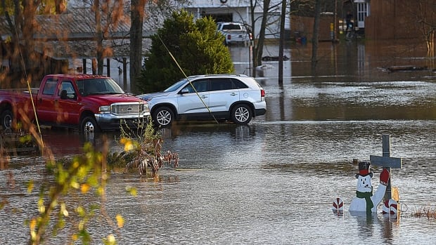 In this Friday, Dec. 25, 2015 photo, flood waters from the Chattahoochee River covers streets in Columbia, Ala.
