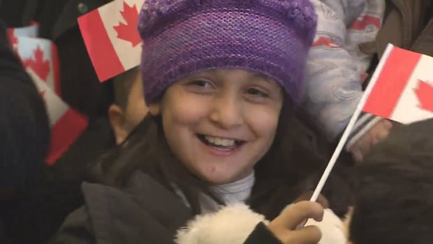 Mohammad Kurdi's daughter waves Canadian flag at YVR