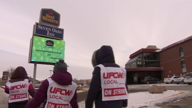 Restaurant and hotel staff walk the picket line on Albert Street in Regina.