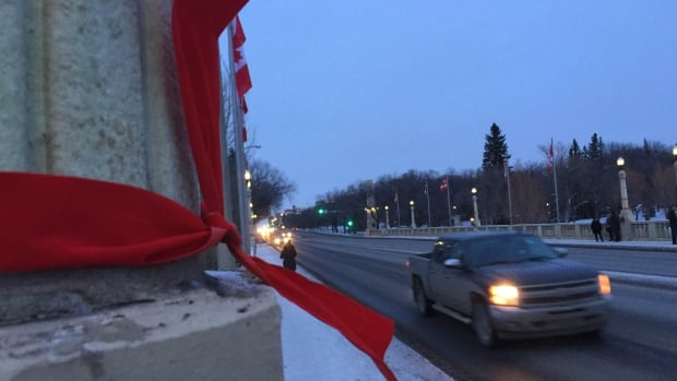 Red ribbons were tied in Regina on Dec. 28 to raise awareness for missing and murdered indigenous women.