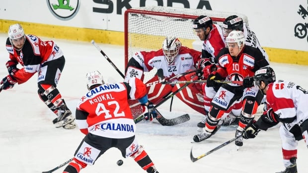 Team Canada's goalkeeper Drew Macintyre suffered an unspecified injury in a 2-0 win over HC Davos on Monday.