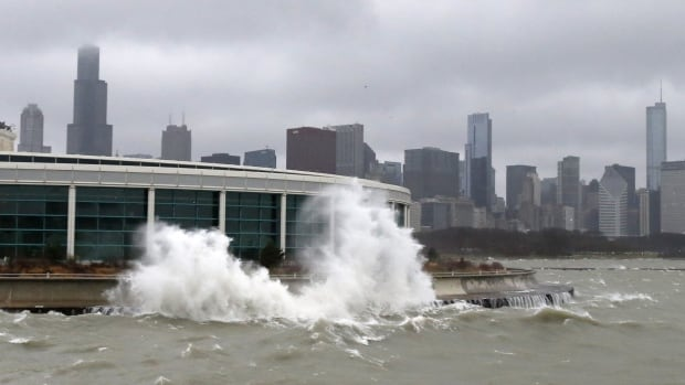 Wind-blown waves from Lake Michigan break around Chicago's Shedd Aquarium on Monday as the winter storm arrived.