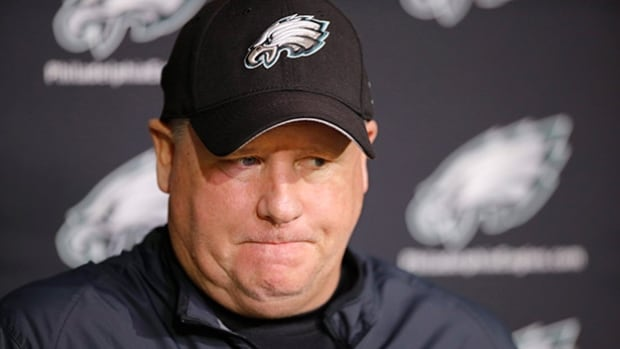 Former Philadelphia Eagles coach Chip Kelly, above, listens to a question during a news conference on Monday in Philadelphia.