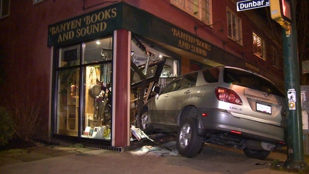 A man is unhurt after driving a Lexus SUV into the front of Banyen Books in Vancouver, early Wednesday morning.