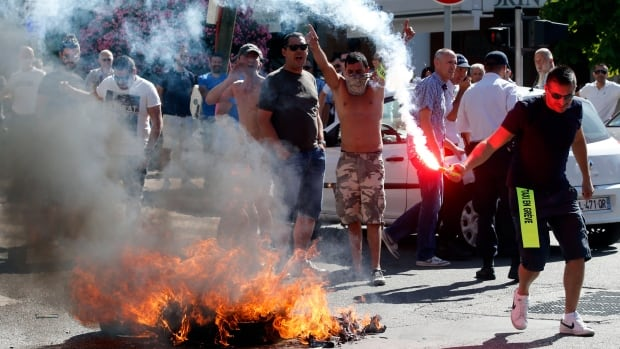 Taxi drivers on strike burn tires during a national protest against ride-booking service Uber in Marseille, France, on June 25, 2015.