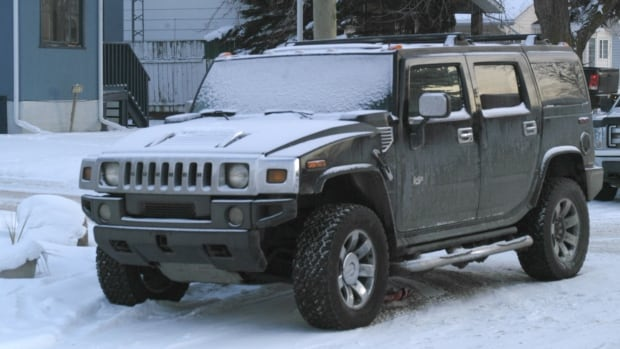 Stettler RCMP believe the suspect, dressed as Santa Claus, made away in this Hummer H2 and then ditched the SUV for a second getaway vehicle, an older-model pickup truck.