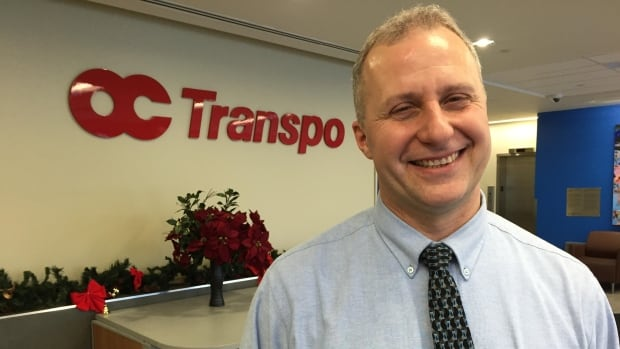 Carlo DiFelice stood in a snowbank and helped passengers board his bus during Tuesday's snowstorm in Ottawa. A video capturing his efforts has been viewed online more than 400,000 times.