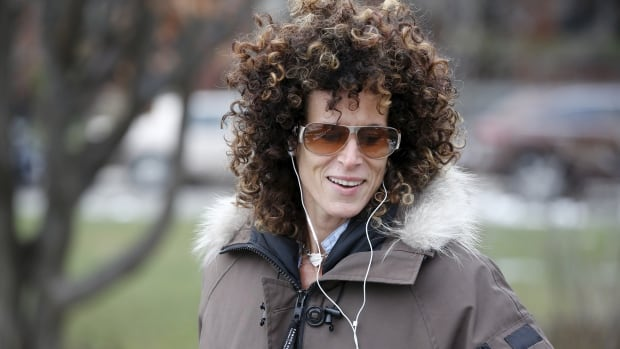 Andrea Constand, 42, walks her dogs in Toronto on Dec. 30, 2015. The former basketball player and coach has accused comedian Bill Cosby of sexual assault.