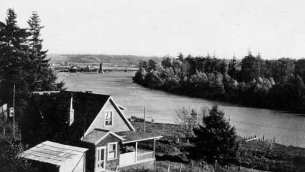 Poplar Island seen from River Road ca. 1913. Over the years, Poplar Island has been home to the Qayqayt First Nation, a smallpox containment facility, shipbuilding, and pulp and paper facilities, but is uninhabited today.
