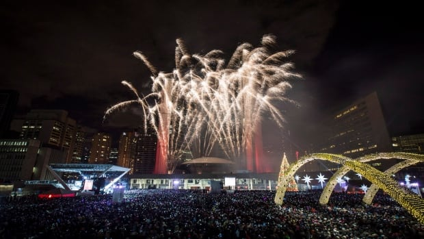 Fireworks go off during New Year's Eve celebrations at Nathan Phillips Square in Toronto on January 1, 2014.