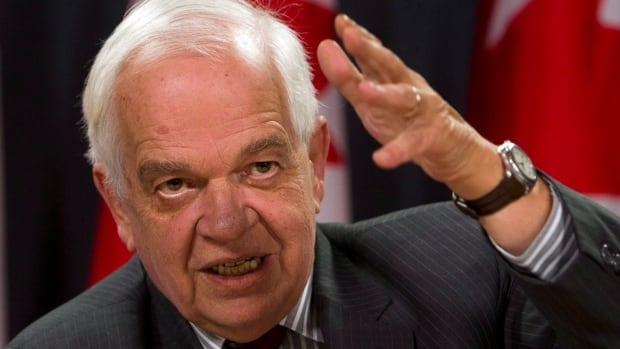 Immigration Minister John McCallum holds a news conference to update the Syrian refugee situation, in Ottawa, Wednesday, December 23, 2015.