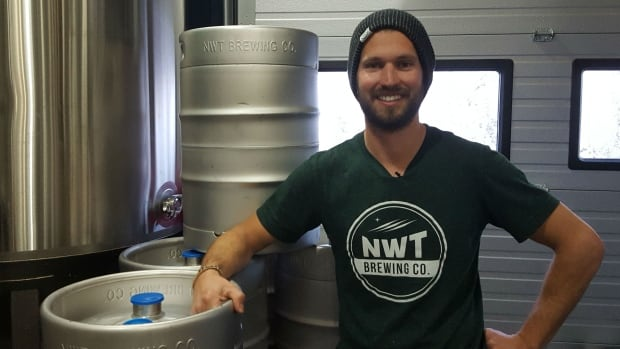 Fletcher Stevens poses with his first batch of beer at the N.W.T. Brewing Co. 'We're ecstatic that we can finally produce something locally that people will actually get to try.'