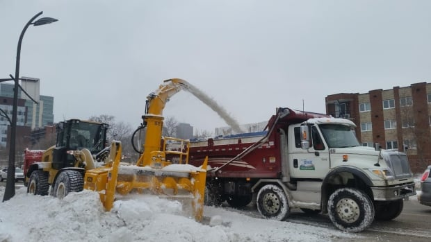 Snow removal crews clean up in Gatineau on Dec. 30, 2015, after the city was blanketed with about 26 centimetres of snow the day before. Ottawa-Gatineau residents have been voicing their displeasure with the slow pace of the cleanup efforts.
