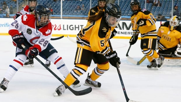 Boston Pride's Kelly Cooke (5) handles the puck in front of Montreal Les Canadiennes' Marie-Philip Poulin in the women's Winter Classic.  Les Canadiennes begin their playoff series against Toronto on Friday.