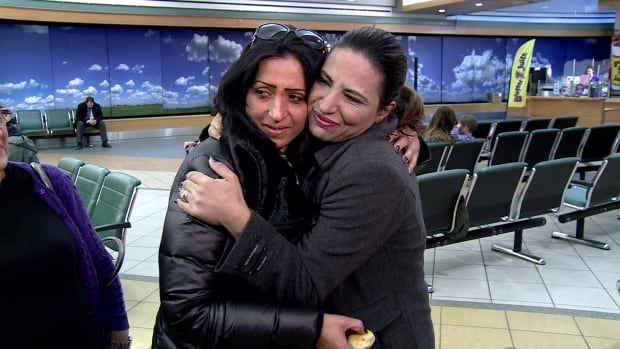 Laila Maaen, left, and her sister, Janet Machtoub, were reunited Thursday at Edmonton International Airport.
