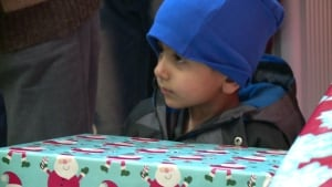 Syrian child receives gift at event