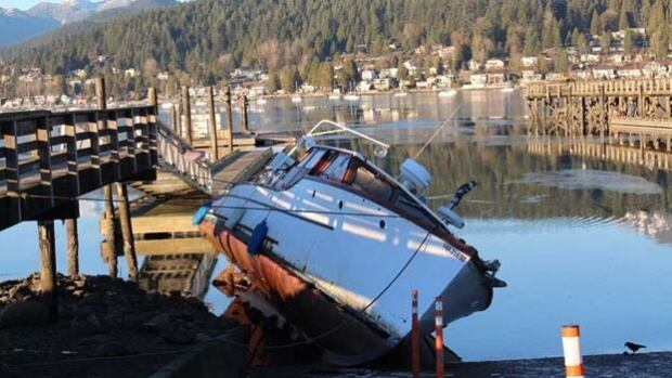 This vessel on the shoreline at the Rocky Point boat launch in Port Moody forced the cancellation of the city's annual New Year's Day swim.