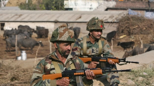 Indian army soldiers stand guard near the Indian Air Force (IAF) base at Pathankot in Punjab, India, on Jan. 3, 2016. A gun battle at the base lasted at least 14 hours Saturday.