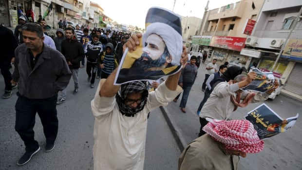 Demonstrators in the Bahrain village of Manama protest against the Saudi execution of Shia cleric Nimr al-Nimr. Police fired water cannons and birdshot at protesters.