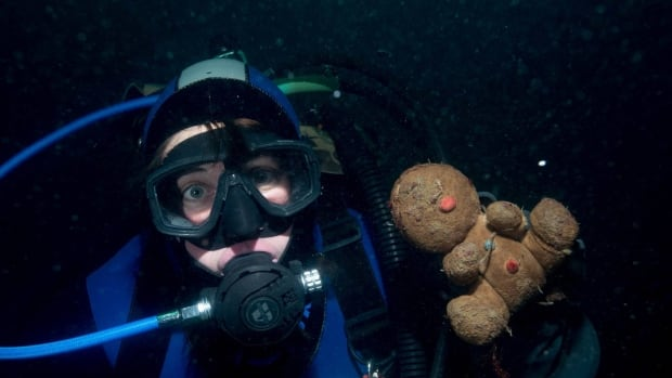 Natasha Dickinson, pictured above, found this teddy bear in the waters off Port Hardy, B.C. on New Year's Day. She and her diving companion, Jackie Hilderling, hope to find its owner.