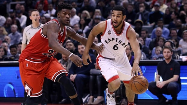 Cory Joseph of the Toronto Raptors, right, dribbles the ball past Jimmy Butler of the Chicago Bulls at the Air Canada Centre on Sunday in Toronto.