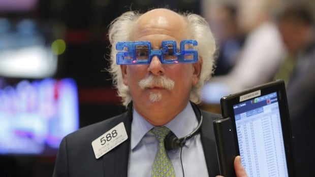 Trader Peter Tuchman wears plastic glasses to celebrate the last trading day of 2015 as he works on the floor of the New York Stock Exchange shortly after the opening bell in New York Dec. 31, 2015. There's no such thing as a safe investment, but there are investments that are right for you.