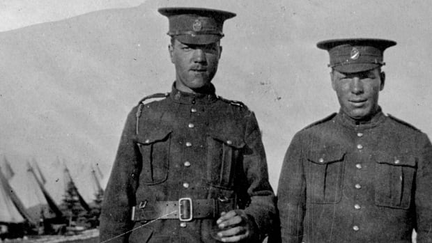 The Betts brothers Earl, left, and Clarence train with the 113th Battalion Lethbridge Highlanders at Camp Sarcee near Calgary in 1916.