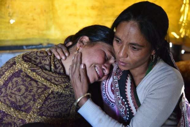 India earthquake women family Imphal