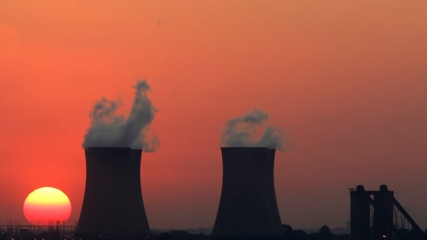 The sun sets behind the cooling towers of the Hendrina Power Station in South Africa. Thermoelectric plants, including nuclear and fossil-fuel based generators, need fresh water to cool their systems.