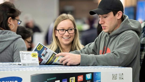 Customers shop at a Best Buy store in Ottawa on Black Friday. Despite the limping loonie, Canadian prices have been better than American ones when exchange rate is included.