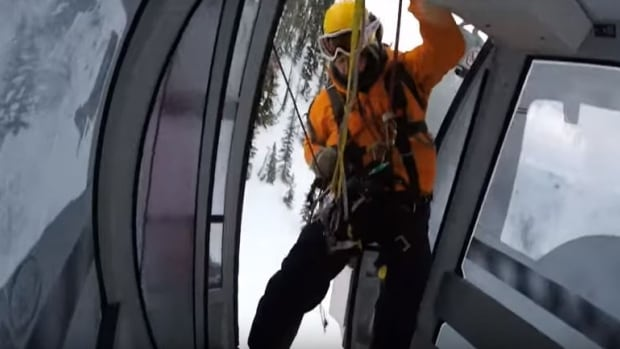 A member of the Kicking Horse Mountain Resort Safety Team enters the gondola to rescue passengers on Jan. 3.