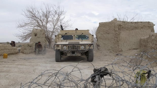 "An Afghan National Army vehicle is seen parked at an outpost in Helmand province, Afghanistan in late December 2015. The U.S. military command in Kabul said one armed forces member died of wounds sustained ""during operations"" in Marja, and that two were wounded."