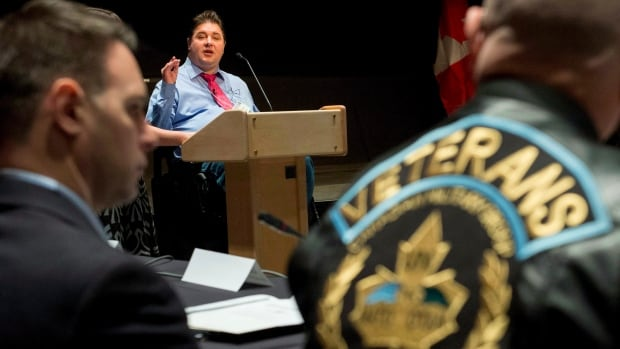 Minister of Veterans Affairs Kent Hehr speaks to stakeholders and veterans at a stakeholder summit at the Canadian War Museum in Ottawa on Wednesday, Dec. 2, 2015. A new study from the Government of Canada finds that at least 2,250 veterans are homeless.