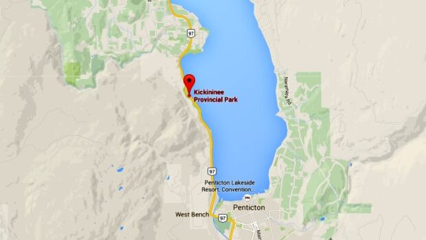 A woman died after her SUV slipped off of Highway 97 into Okanagan Lake on Tuesday.