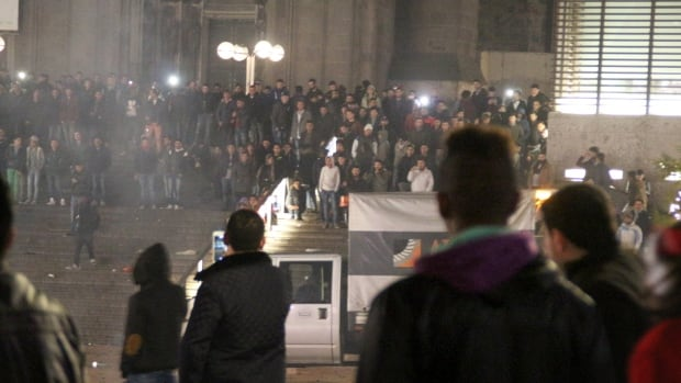 People gather at the main train station in  Cologne, Germany on Dec. 31, 2015. Cologne prosecutors said an asylum-seeker has become the first person arrested on suspicion of sexual assault following a string of incidents at New Year's celebrations that led 497 women to come forward.