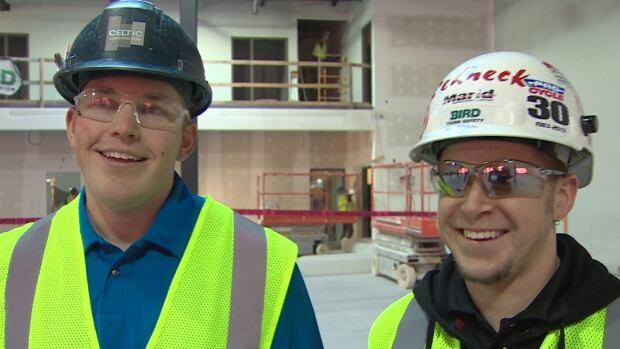Scott Boyd (left), an apprentice carpenter, and Nick Deveau, a red seal carpenter, both work for Bird Construction.