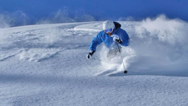 A skier carves some powdery turns at the Apex Mountain Resort near Penticton, B.C.