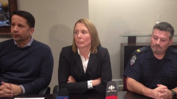 Lawyer T.J. Burke, Cherie Campbell, and Cpl. Shane Duffy at a Wednesday news conference.