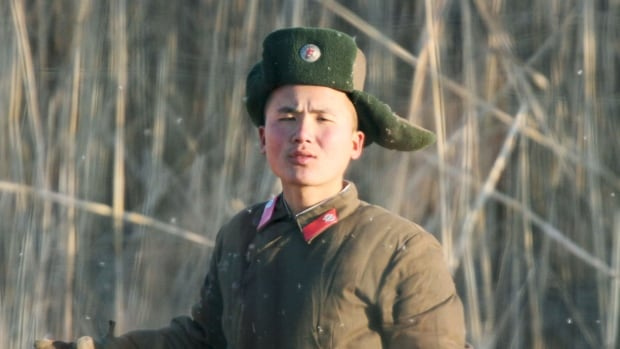 A North Korean soldier is seen near the North Korean town of Sinuiju, as seen from the opposite Chinese border city of Dandong, on Wedfnesday. North Korea said it successfully tested a miniaturised hydrogen nuclear bomb, setting off alarm bells in Japan and South Korea, which has resumed its anti-Pyongyang propaganda broadcasts.